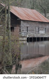 Covered Bridge with tin roof over water
