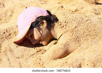 Covered by sand at the beach