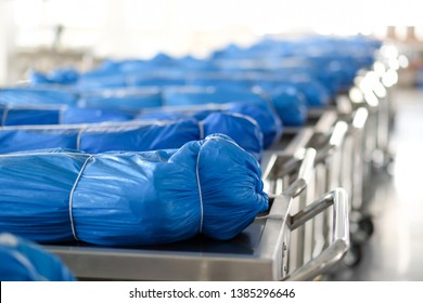Covered cadavers with blue fabric