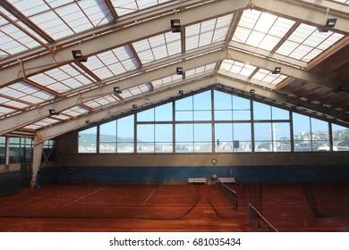 Covered clay tennis court in San Sebastian, Spain.