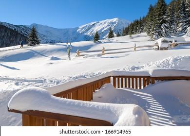 Covered in fresh snow terrace of mountain refuge hut on Hala Kondratowa in Tatry Mountains, Poland