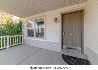Covered front porch with grey and white decor