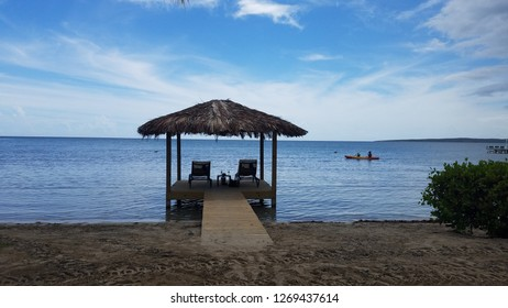 covered hut on dock with chairs on water in Guanica, Puerto Rico