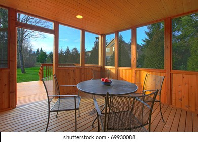 Covered screen porch with dining table