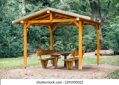 Covered seating area. Gazebo, pergola in parks and gardens - relax and unwind. Wooden gazebo in the Park