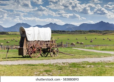 covered wagon against a mountain landscape