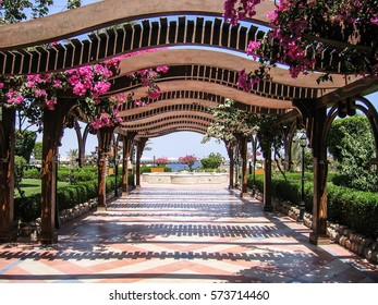 Covered walkway arches with flowers to beach in Egypt