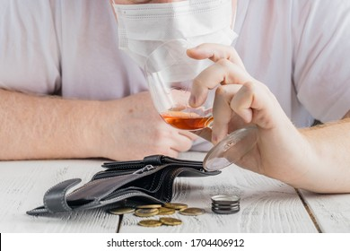 covering a glass of alcohol with medical face mask. Concept of cancelled social events during pandemic and corona virus quarantine