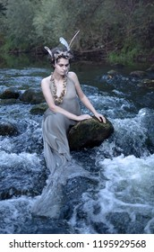 covering his eyes mermaid sitting on the rocks in the river, pretends to be a modest insidious evil, attracts travelers, then drown them will be in the cold fast flowing water, mermaids are all, prete