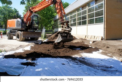 Covers of a geotextile as' protection against toxic soil contamination. Application of clean soil with the excavator