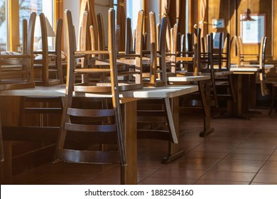 Covid 19 and closed restaurant with chairs on tables because of lockdown or shutdown. horizontal