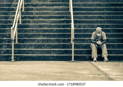 Covid 19 nurse sitting on the hospital steps de stressing from work.