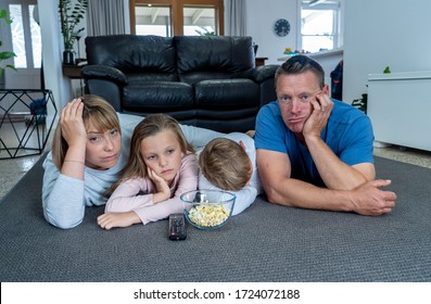 COVID 19 Outbreak. Bored and frustrated family watching tv at home feeling depressed  Mental health Impact of lockdown social distancing and Job losses due to coronavirus.