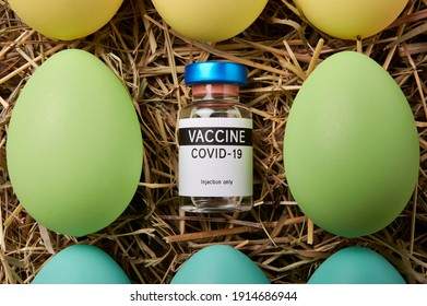 Covid 19 vaccine units delivery to easter. Gift from the Easter Bunny to fight Covid-19 packed in colorful Easter eggs