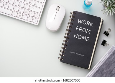 Covid 19 work from home concept. Pandemic Covid-19 Coronavirus quarantine concept. Mockup notebook for Covid19. Social distancing employee work at home to prevent virus infection in Covid-19 Outbreak.