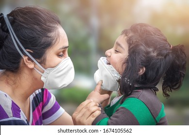 Covid-19 Coronavirus and Air pollution pm2.5 concept. Little Indian baby girl and mother wearing mask in public crowded place for protect and to stop corona virus outbreak
