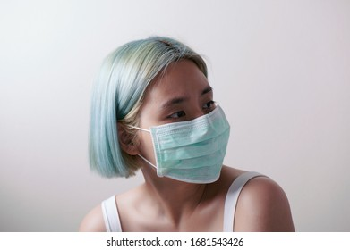 Covid19 Coronavirus and Air pollution pm2.5 concept. asian woman wearing medical masks to protect disease flu.