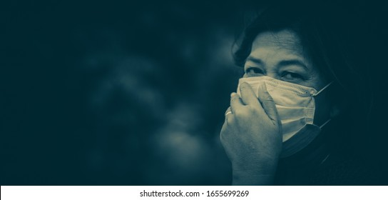 Covid-19 Coronavirus concept.Senior old woman wearing N95 mask for protect virus Covid-19.Social distancing.Healthcare medical mental health.Sickness indian old woman infected.Banner background.