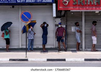 COVID-19 – coronavirus Sri Lanka - People wearing facemasks at outside a shop in Colombo, Sri Lanka, 24 March 2020. Pic by Ruwan Walpola