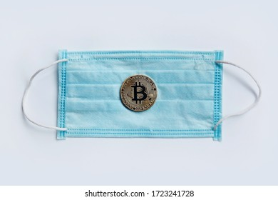 COVID-19 coronavirus in USA, Bitcoin medical coin coin. Coronavirus affects global stock market. Covid-19 Affecting the global economy concept. Money on medical mask. Digital money and medicine.