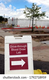 Covid-19 Drive Through Testing Lab Site Sign with Tent in Background