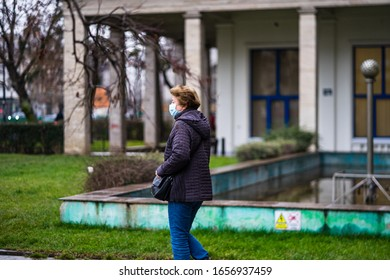 Covid-19 flu disease virus spreading in Europe. People wearing medical mask against corona virus. Healthcare concept. Woman wearing surgical mask on face in public spaces in Bucharest, Romania, 2020