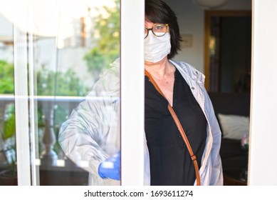 COVID-19 Home isolation, quarantine in coronavirus. Woman in mask and gloves at home isolation auto quarantine for virus SARS-CoV-2. voluntary isolation surgical mask on face.  Stay at home.