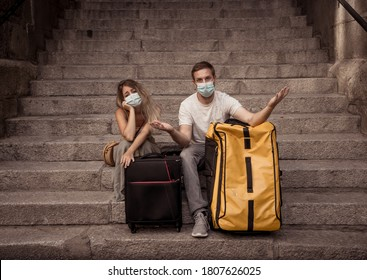 COVID-19 impact in international tourism. Sad tourist couple worried about coronavirus quarantine back home amid new travel regulations. Vacations cancellations due to coronavirus travel restrictions. - Shutterstock ID 1807626025