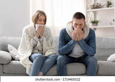 Covid-19 infected family. Sick man and woman coughing at home interior