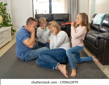 COVID-19 Isolation and mental health. Stressed out parents struggling with having the children at home during Coronavirus lockdown. Mother and father coping with anxious kids fighting in quarantine.