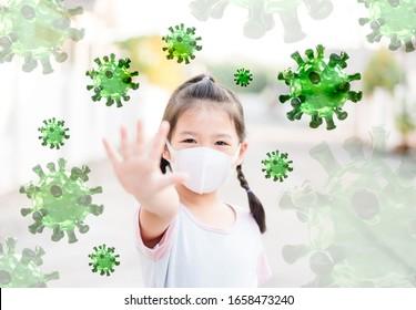 Covid-19 Kawasaki disease in children.Little asian chinese girl wearing mask for Virus show stop hands gesture for stop coronavirus outbreak.Covid19 coronavirus, New normal, Reopen school, Healthcare.