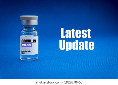COVID-19 LATEST UPDATE text with vial on blue background. Covid-19 or Coronavirus Concept