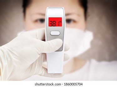 Covid-19 outbreak around the world. Digital thermometer for measuring body temperature display 38.1 degrees celsius