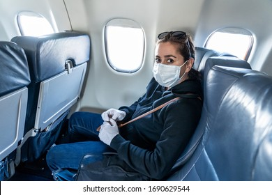 COVID-19 Pandemic border closures. Young woman on the plane returning home city after being stuck in a foreign country as governments have restricted travel to stop the coronavirus spread.