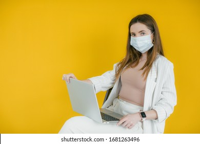 COVID-19 Pandemic Coronavirus Mask Woman Home Working. Girl wearing face mask smart home working on laptop computer. Quarantine. Distant work