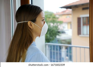 COVID-19 Pandemic Coronavirus Woman home isolation auto quarantine wearing face mask protective for spreading of disease virus SARS-CoV-2. Girl isolation mask on face against Coronavirus Disease 2019.