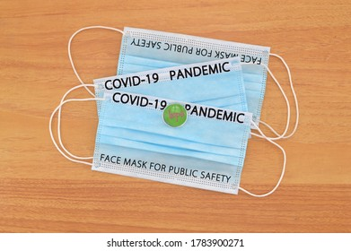 COVID-19 Pandemic Face Mask for Public Safety on wood grain table