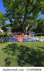 "COVID-19 PANDEMIC, MEDICAL CITY DALLAS, USA, 4-22-2020: ""Heroes work here"" signs are placed all around the hospitals to honor nurses and doctor during the Coronavirus Pandemic in 2019/2020."