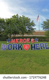 "COVID-19 PANDEMIC, MEDICAL CITY DALLAS, USA, 5-1-2020: ""Heroes work here"" signs are placed all around the hospitals to honor nurses and doctor during the Coronavirus Pandemic in 2019/2020."