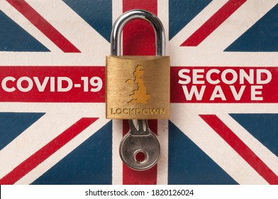 """Covid-19 UK lockdown concept: a lock over a union jack flag with the message """"second wave lockdown"""""""