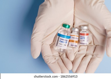 COVID-19 Vaccines for developing country concept. Hand of a Researcher holding Coronavirus 2019-nCoV Vaccine vials. Together, Financial Support poor nations, Alliance, Unicef, WHO, G20, promised.