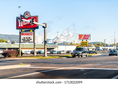 Covington, USA - October 18, 2019: Virginia city in Alleghany county with fast food on street road in small town and pollution from WestRock paper mill