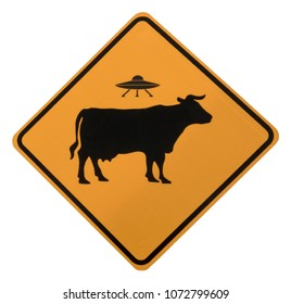 Cow Alien Abduction Road Sign, isolated on a white background, seen along the historic Turquoise Trail between Santa Fe and Albuquerque, New Mexico.