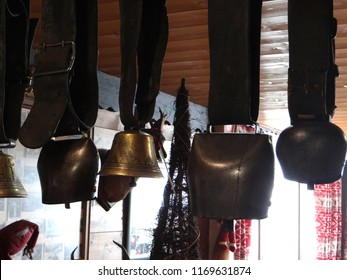 Cow bells on rafters of mountain hut in Chatel, France