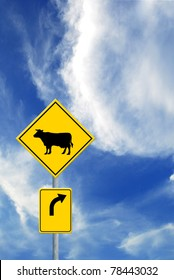 Cow and  Direction sign on sky