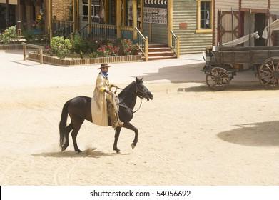 Cowboy bandit riding into town