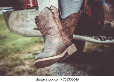 Cowboy boots, a flannel blanket and a tailgate