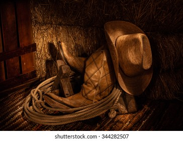 Cowboy Boots, Cowboy Hat, and Lariat in front of Hay Bale / Boots and Hay / Cowboy Gear Still Life