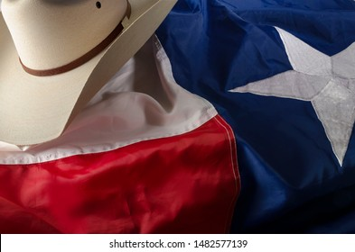 cowboy boots and hat on Texas flag