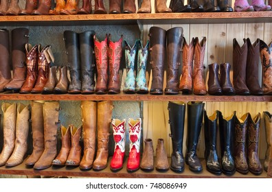 cowboy boots on a shelf in a store, facing straight